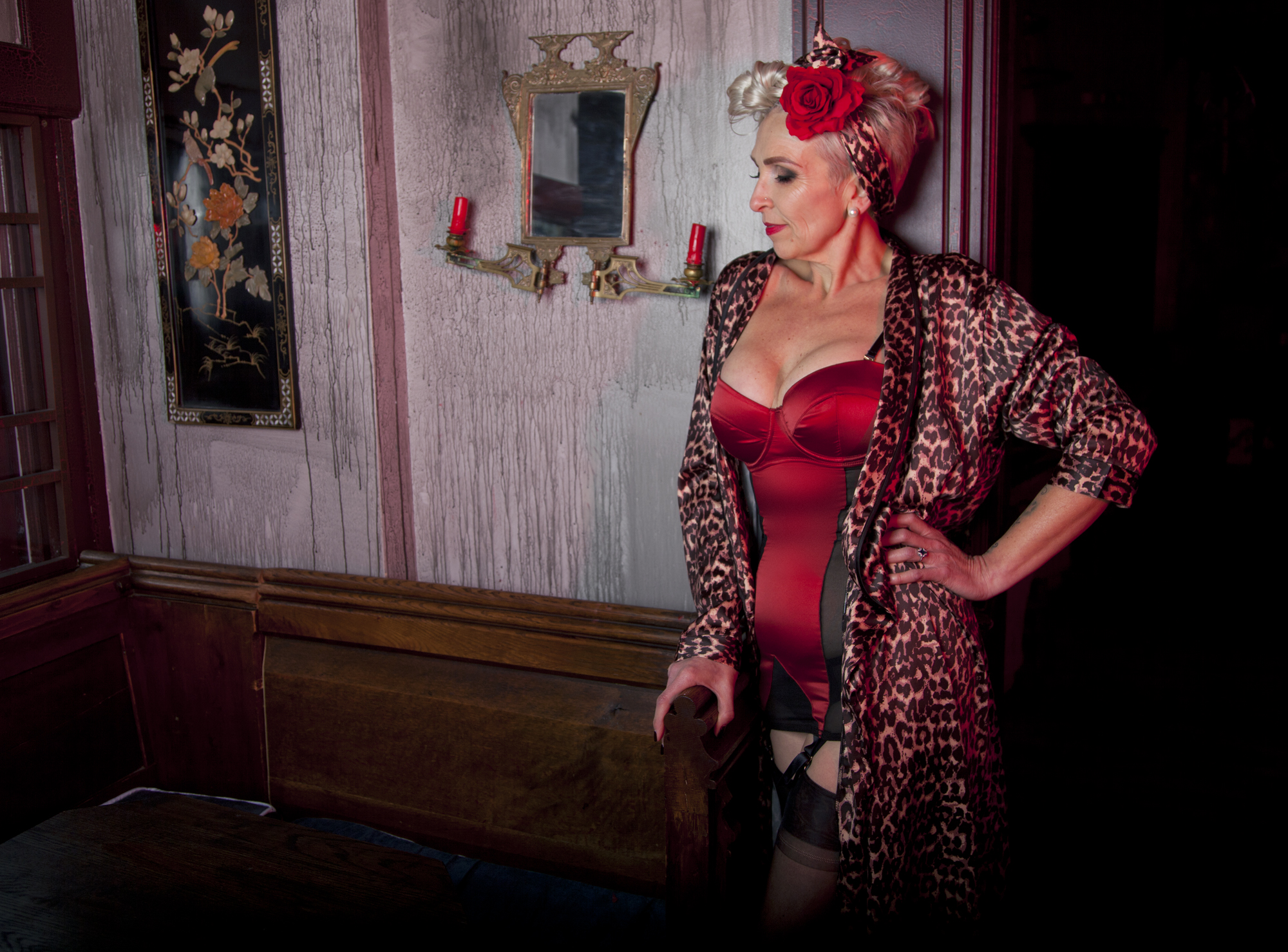 Karen wears the  Bettie Page Red Corsolette  and  Leopard Print Robe,  and a hair flower by our friends at  Bettie Page Hair