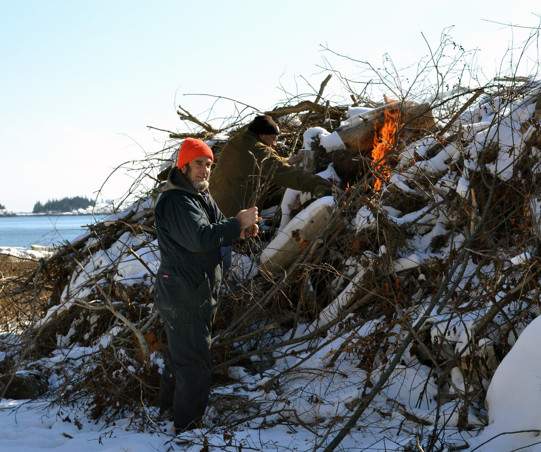 Walt and Jason Day start the pile burning