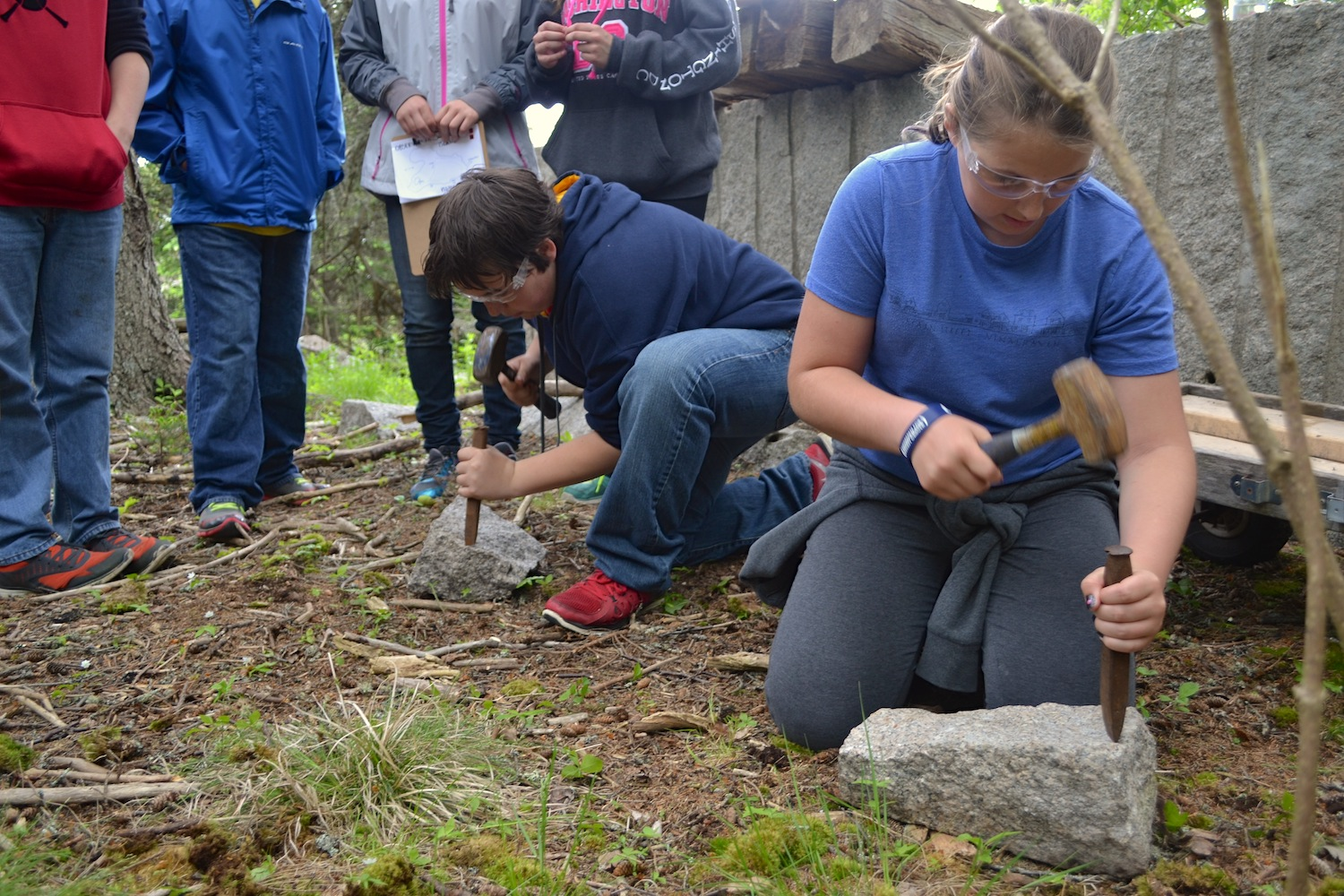 Students try their hand at carving granite