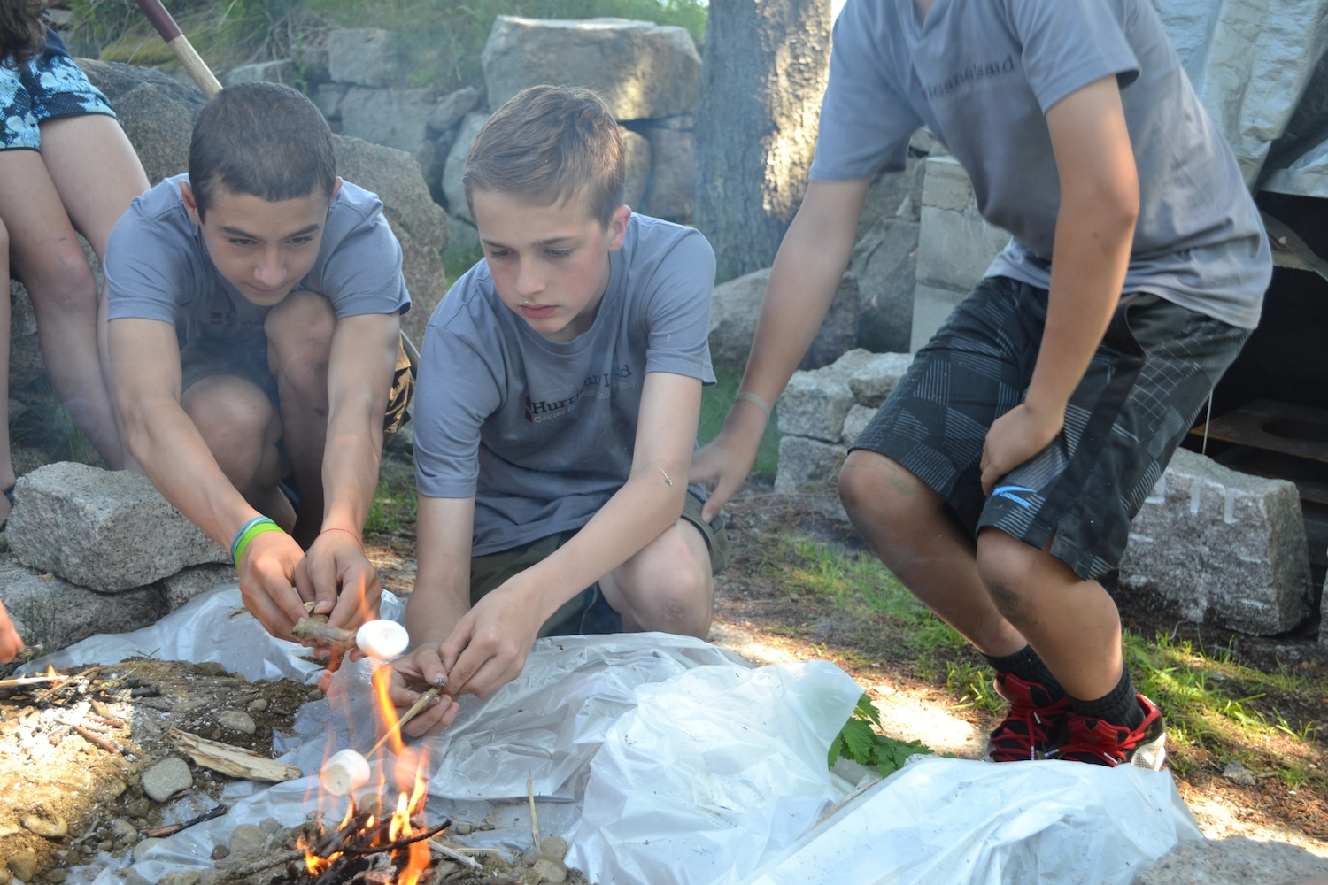 Students enjoy some marshmallows cooked on using the mound fire technique.