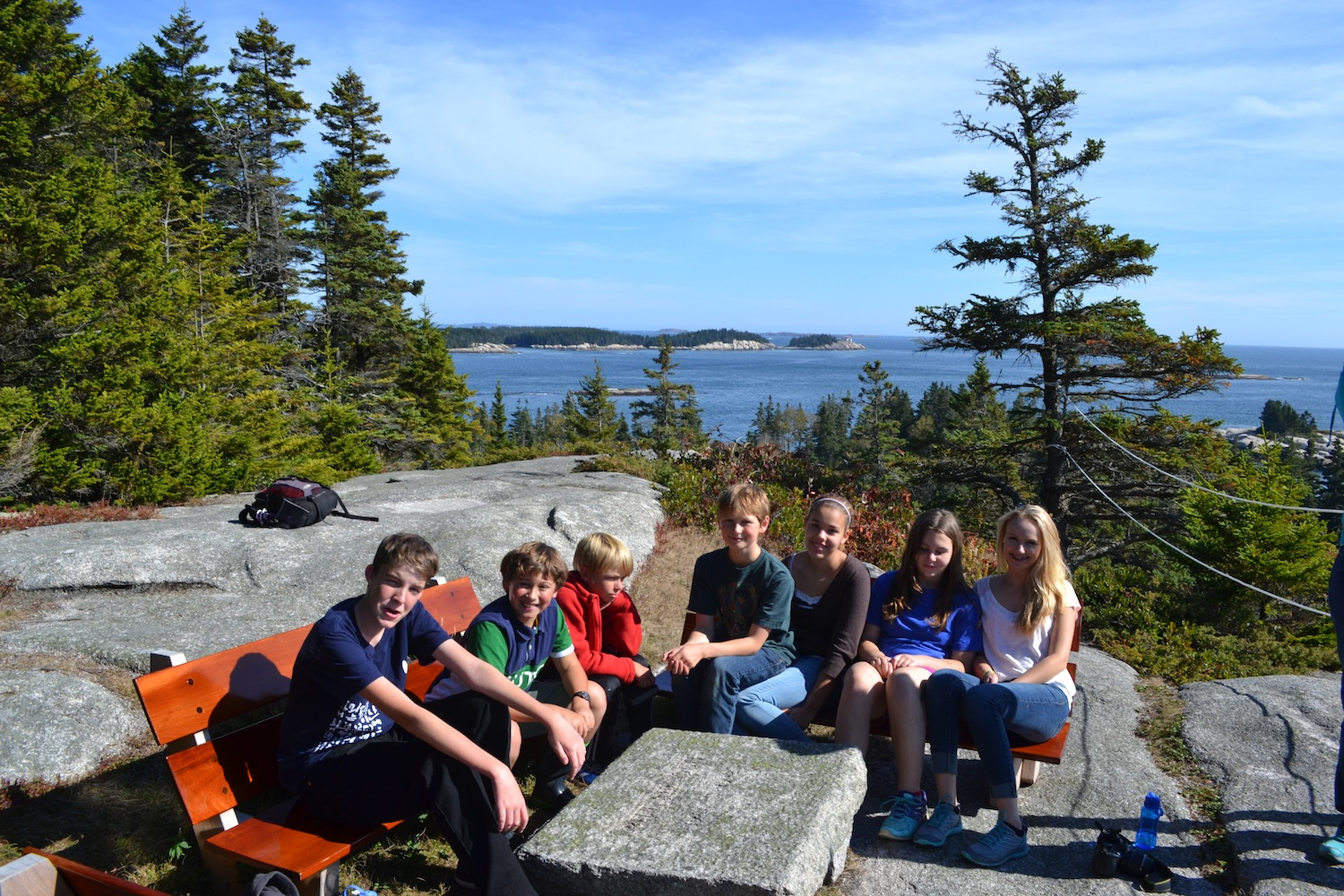 Students enjoy a clear, sunny view at the high cliffs on Hurricane