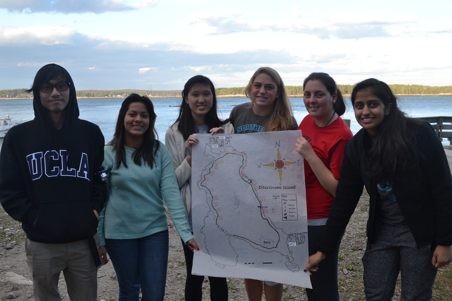 Group 2 shows off their map marking the sample plots they collected along the coastal trail