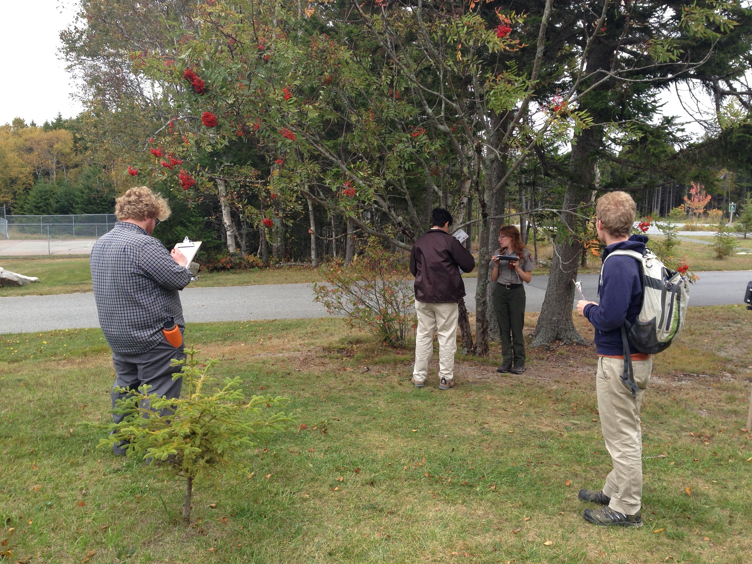 Symposium attendees collecting phenology data.