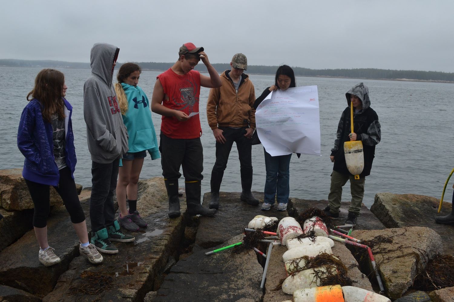 Students share the marine debris art sculptures they created during the 2014 Pathways 101 program on Hurricane