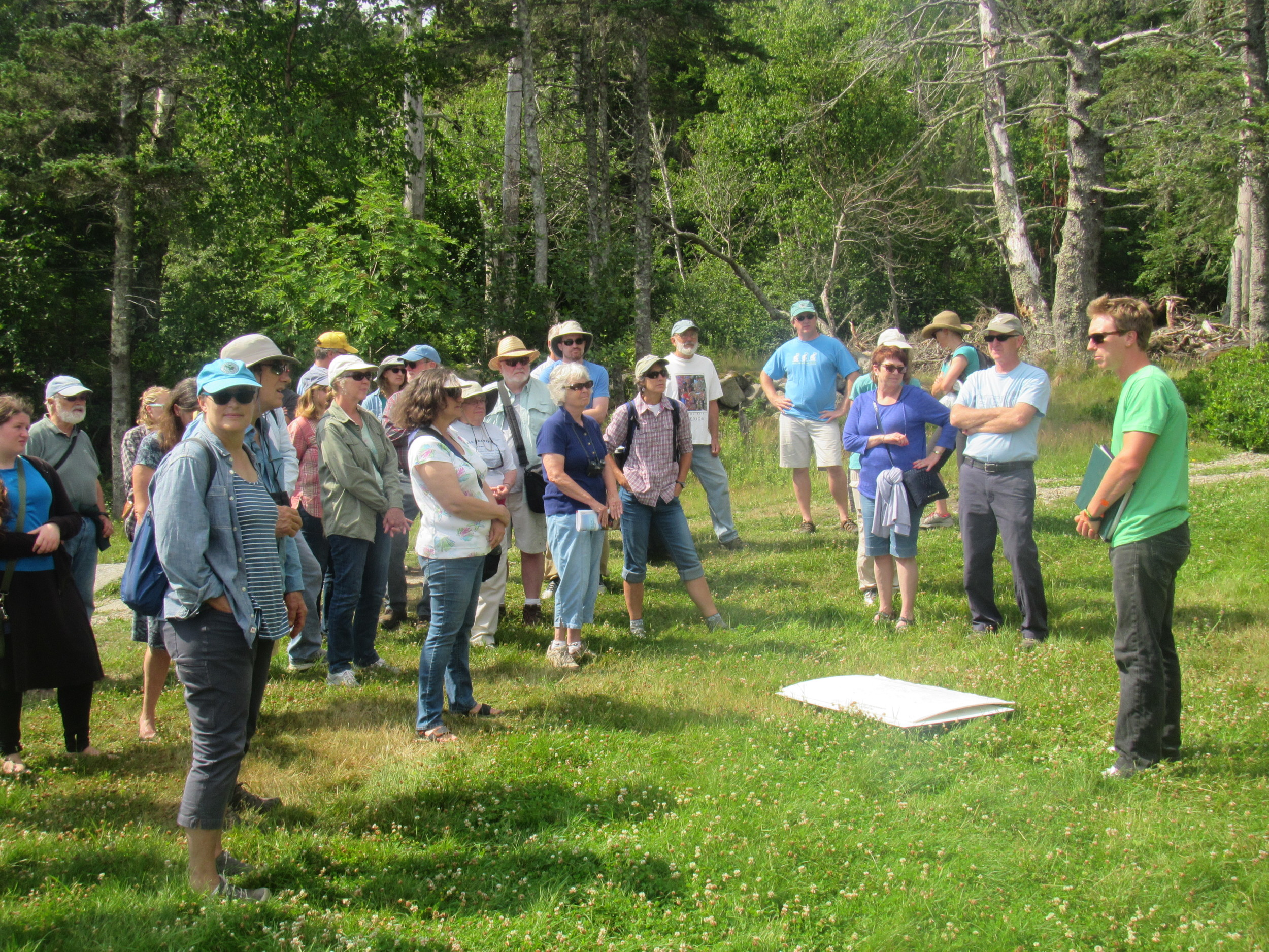 Vinalhaven Land Trust participants touring the facilities with Facilities Manager Oakley Jackson