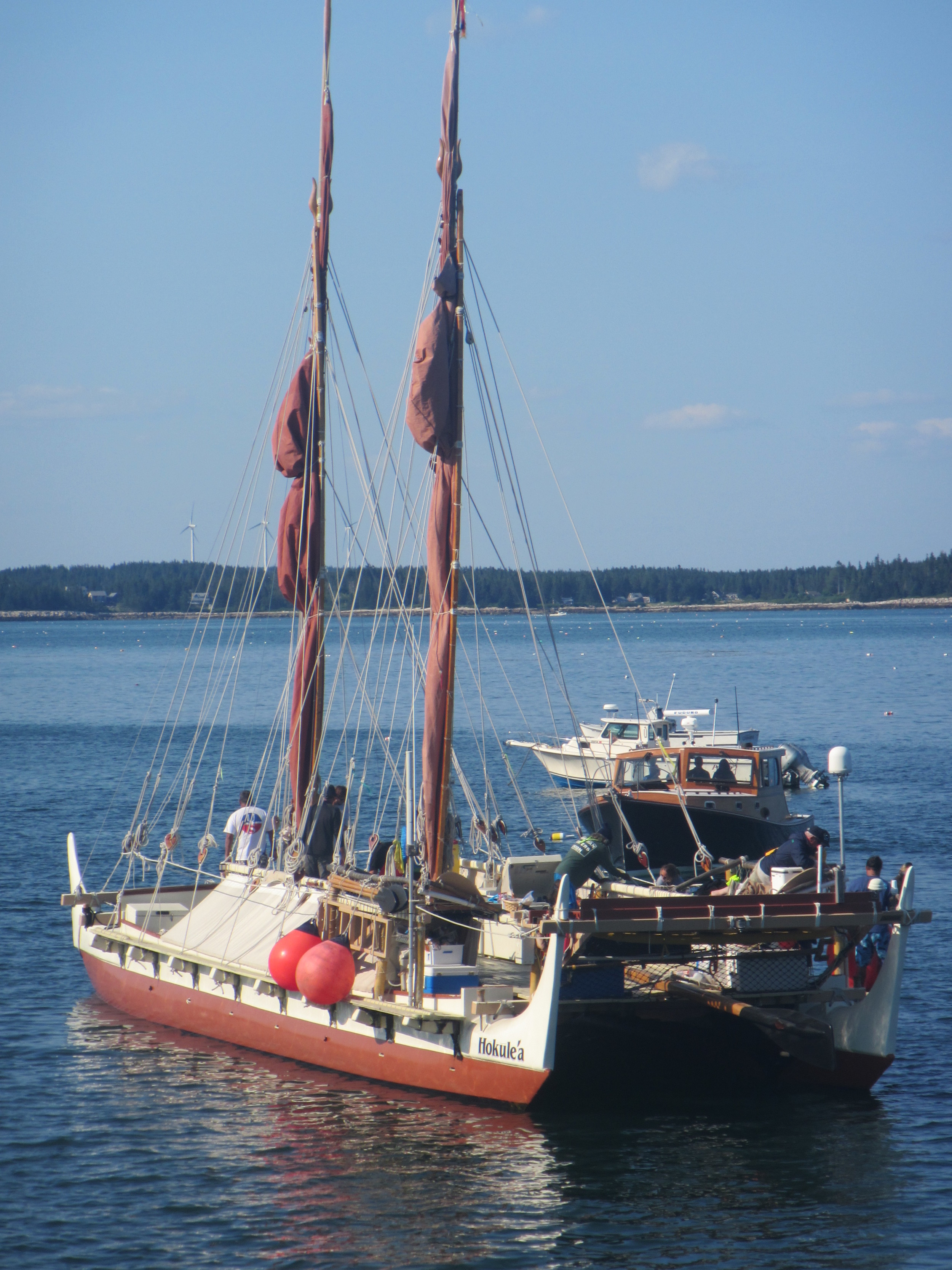 Hokule'a, a traditional sailing canoe from Hawai'i, paying Hurricane Island a visit on their Worldwide Voyage.