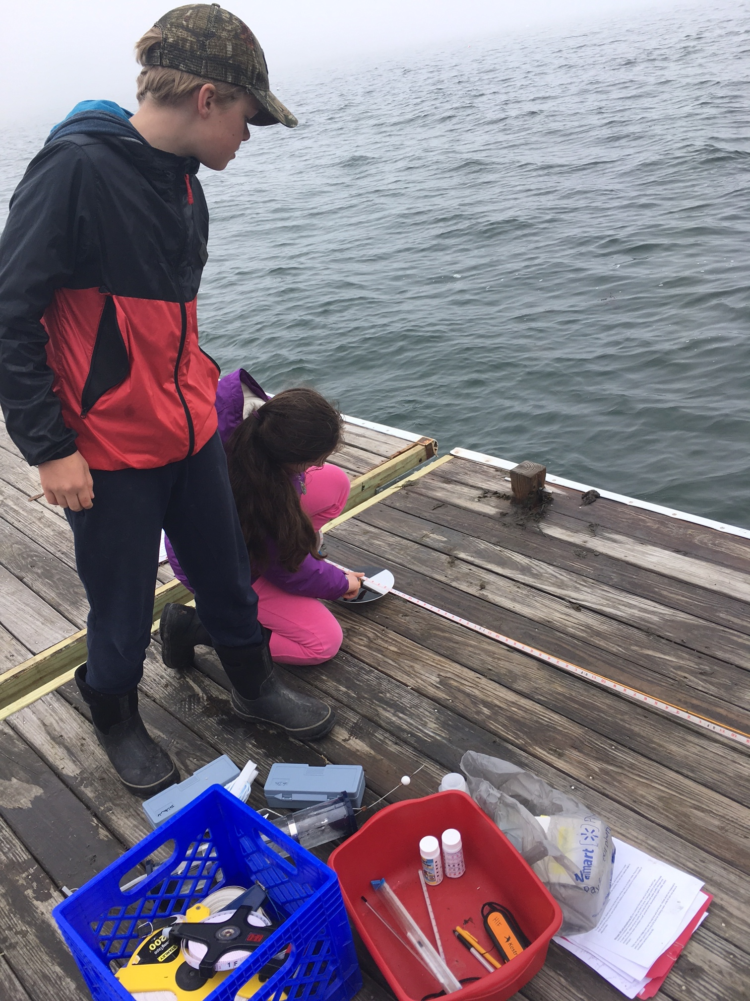 - Students measure water quality at the Hurricane Island dock