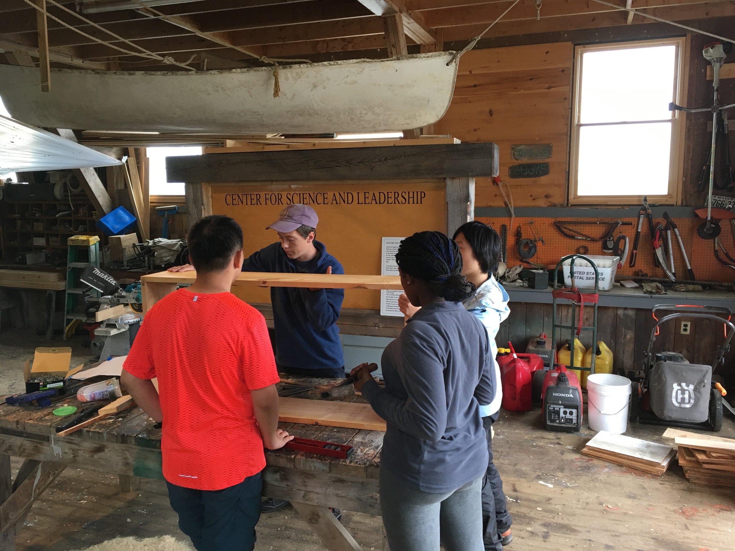 Team big box builds their bin in the Hurricane Island shop