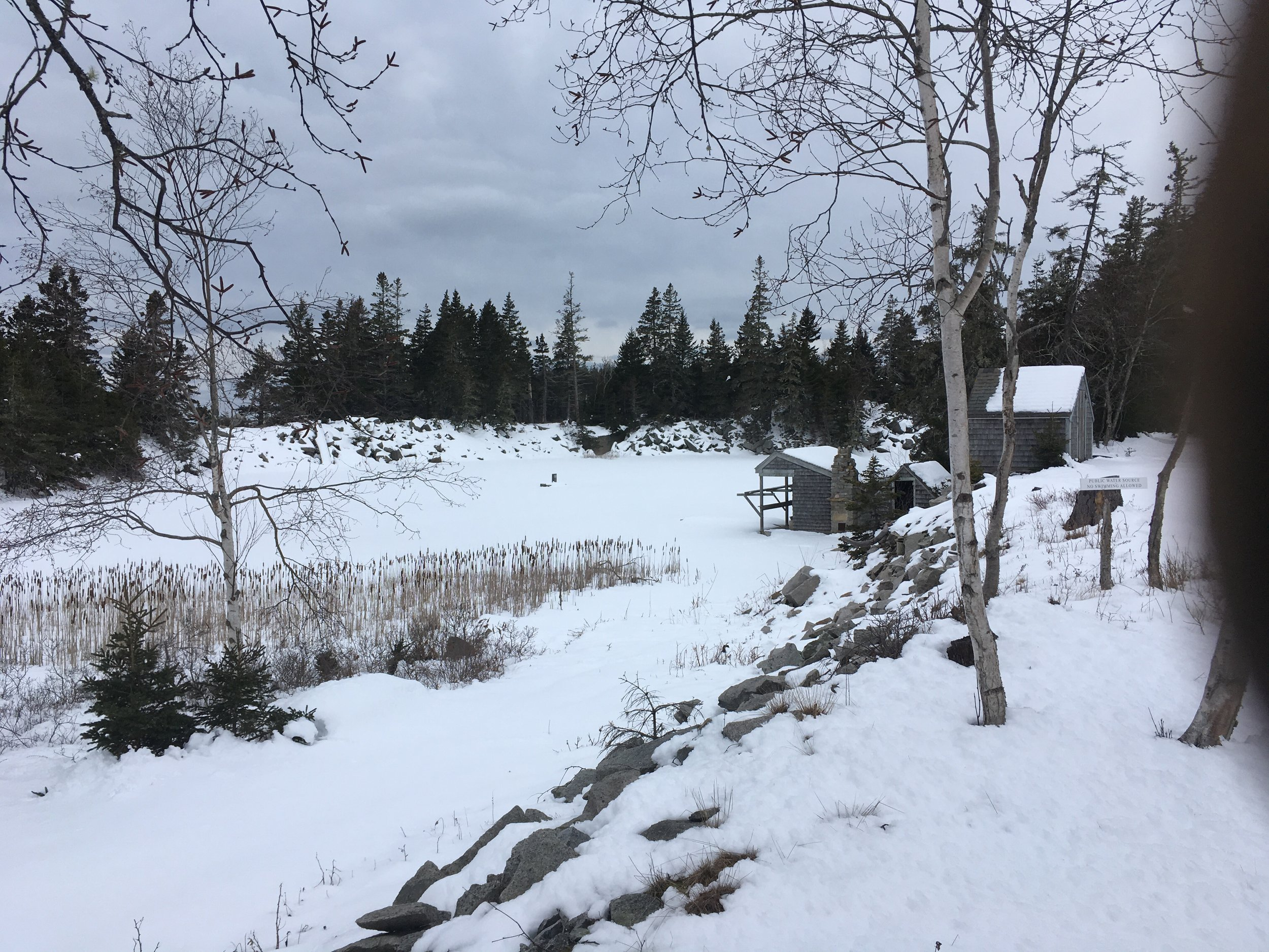 Quarry pond under snow