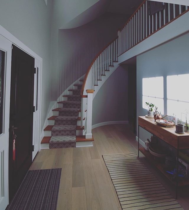 A beautiful staircase can really add character and make a statement in your home. We built this staircase for a home remodel and we love how it adds so much interest to the entrance of this home! #remodel #homeremodel #generalcontractor #generalcontracting #staircase #staircasedesign #foyer #columbusohio #r4rgc