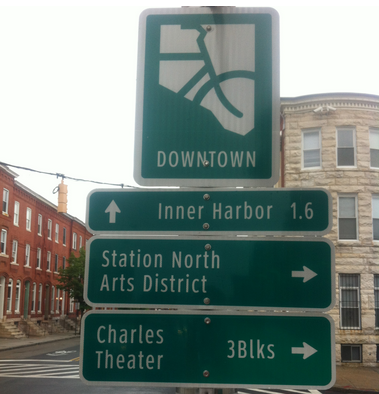Existing bicycle wayfinding signage on Guilford Avenue (photo courtesy of BCDOT).