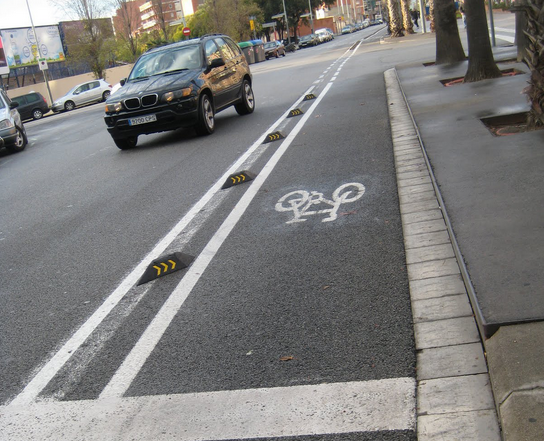 Traffic separators on a bicycle lane in Barcelona. Photo courtesy of  pedalforward.blogspot.com .