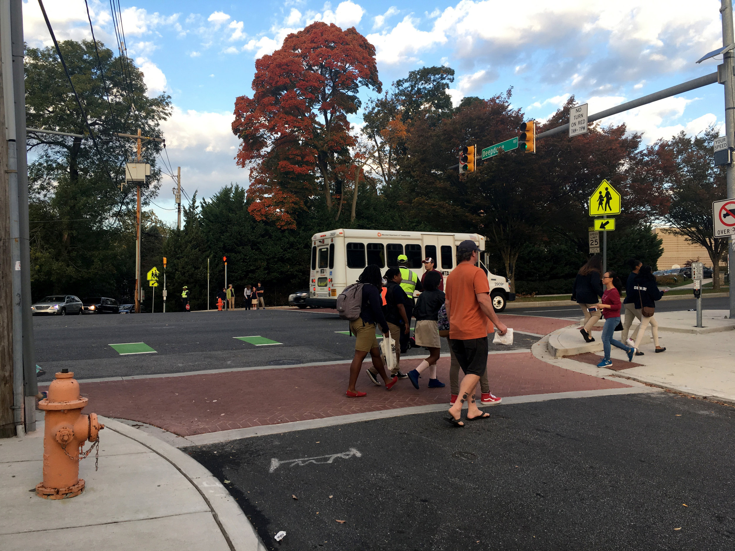 Families make use of the pedestrian infrastructure, improved during the Roland Ave Cycle Track installation