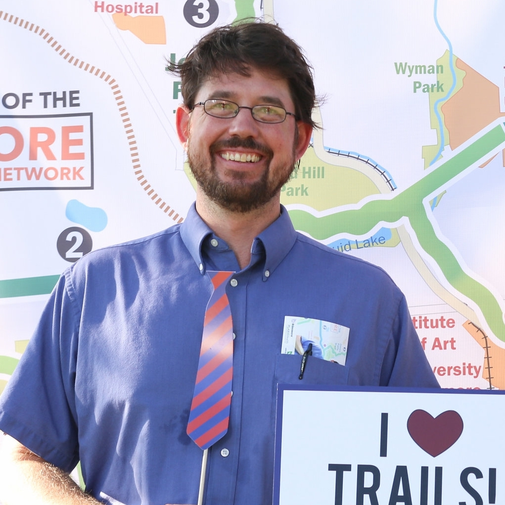 JIM BROWN  Rails-to-Trails Conservancy  Jim is a native Baltimorean, bike commuter, and recreational rider. He is excited to work with Bikemore to make cycling a viable, fun and dignified mode of transportation and recreation for all of Baltimore's residents. Jim works as Manager of Trail Development at the Rails-to-Trails Conservancy and he holds a Masters Degree in landscape architecture from Morgan State University. His prior experience in Baltimore is in the fields of environmental education, city parks, and trails programming.