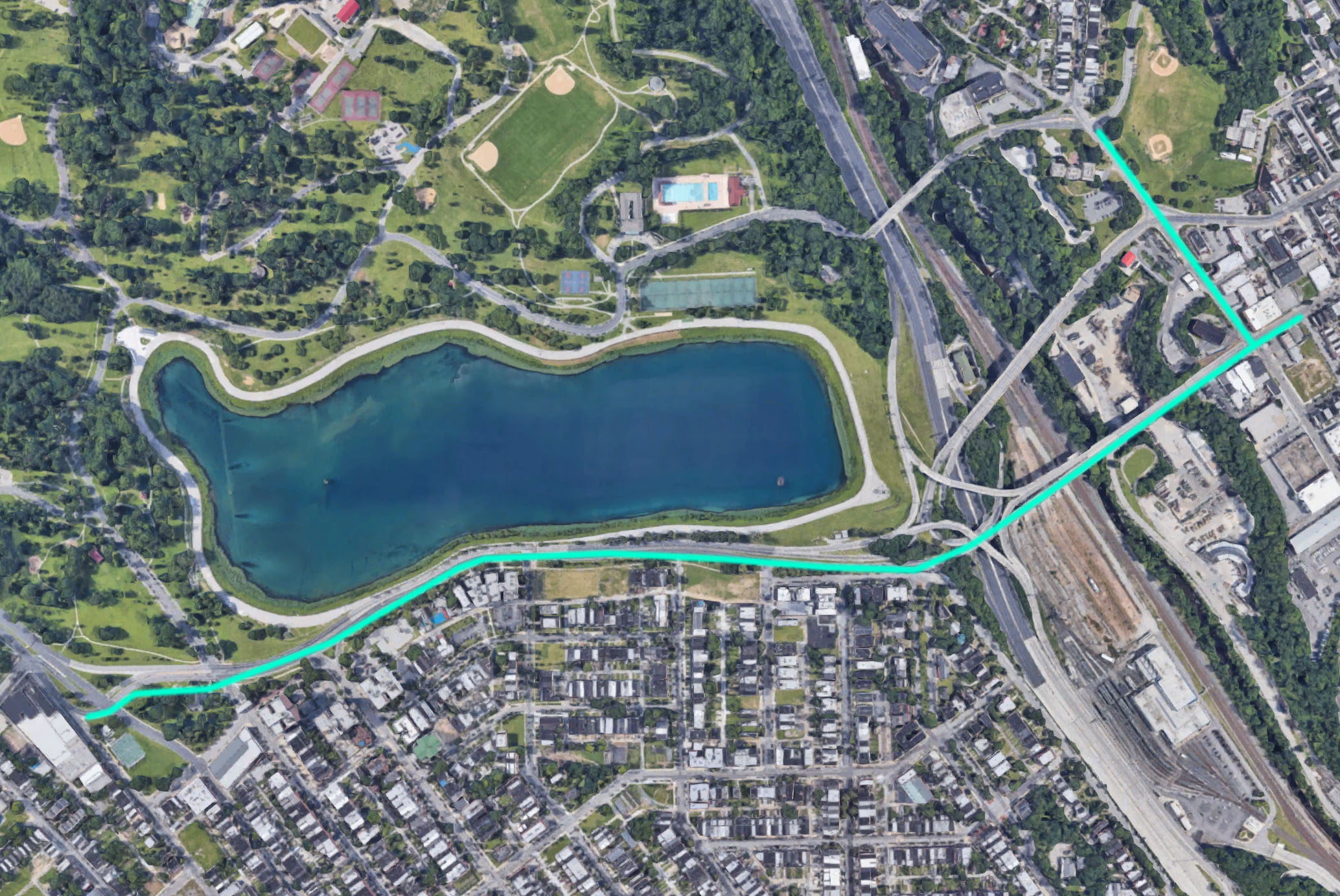 The proposed barrier-protected bike and pedestrian path route is outlined in teal above.