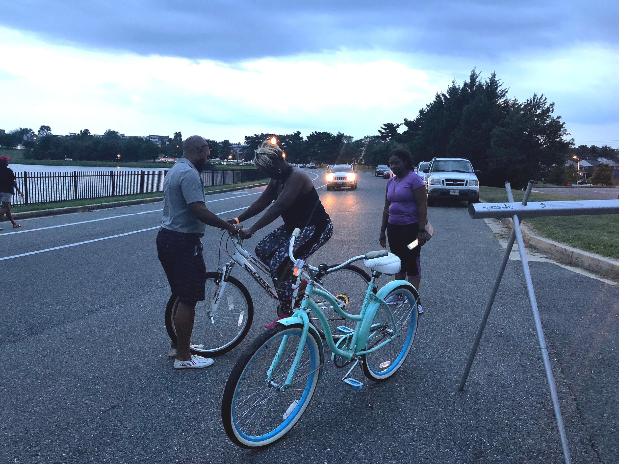 Our new Mobile Bike Shop Coordinator Menelik helped make sure her bike fit properly after we made repairs.