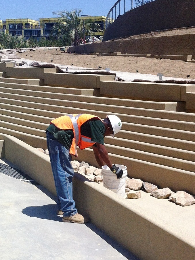 Laying the rocks down for the water feature at the Ocean Avenue entrance