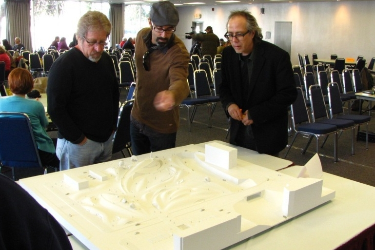 Participants checking out a model of the schematic design