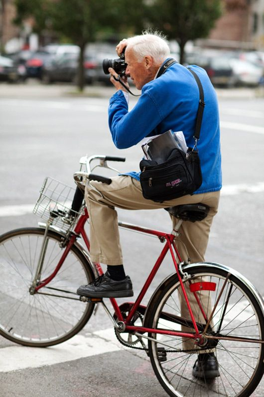 Bill Cunningham on his infamous bicycle