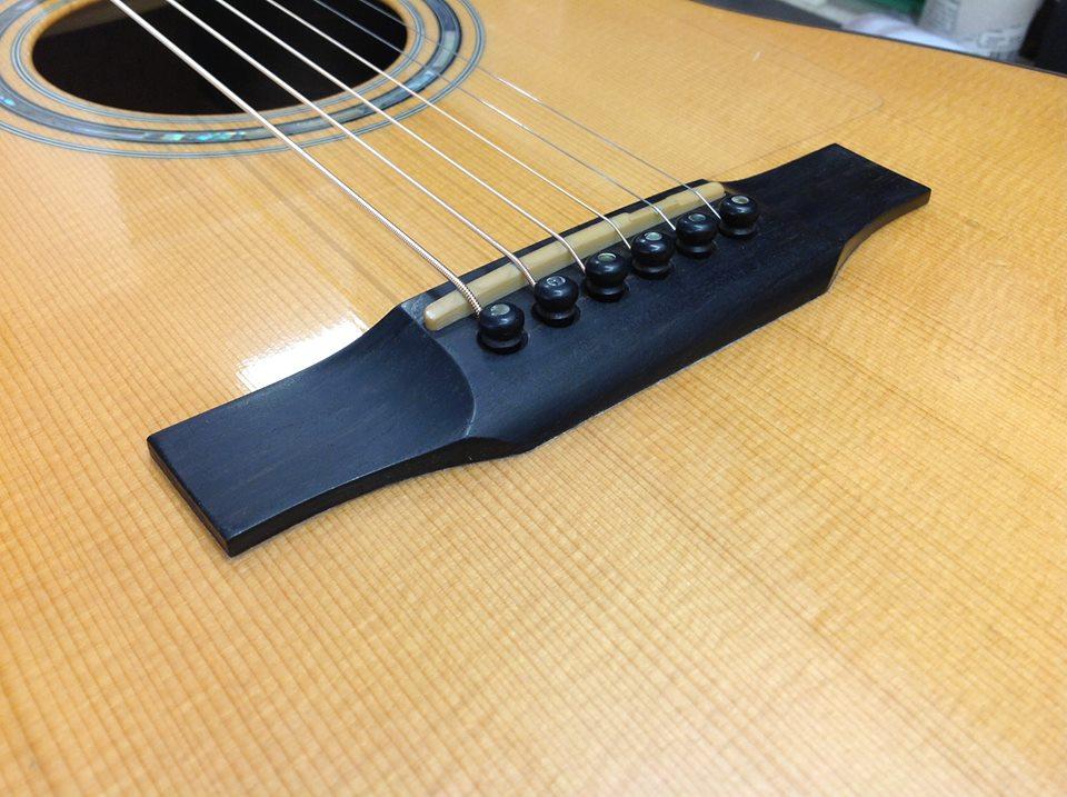 Reglued bridge on acoustic guitar
