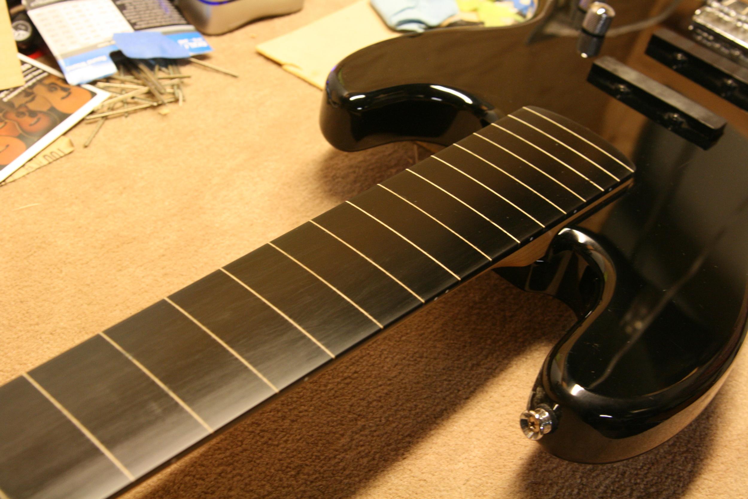 Fretless bass guitar conversion, guitar repair shop