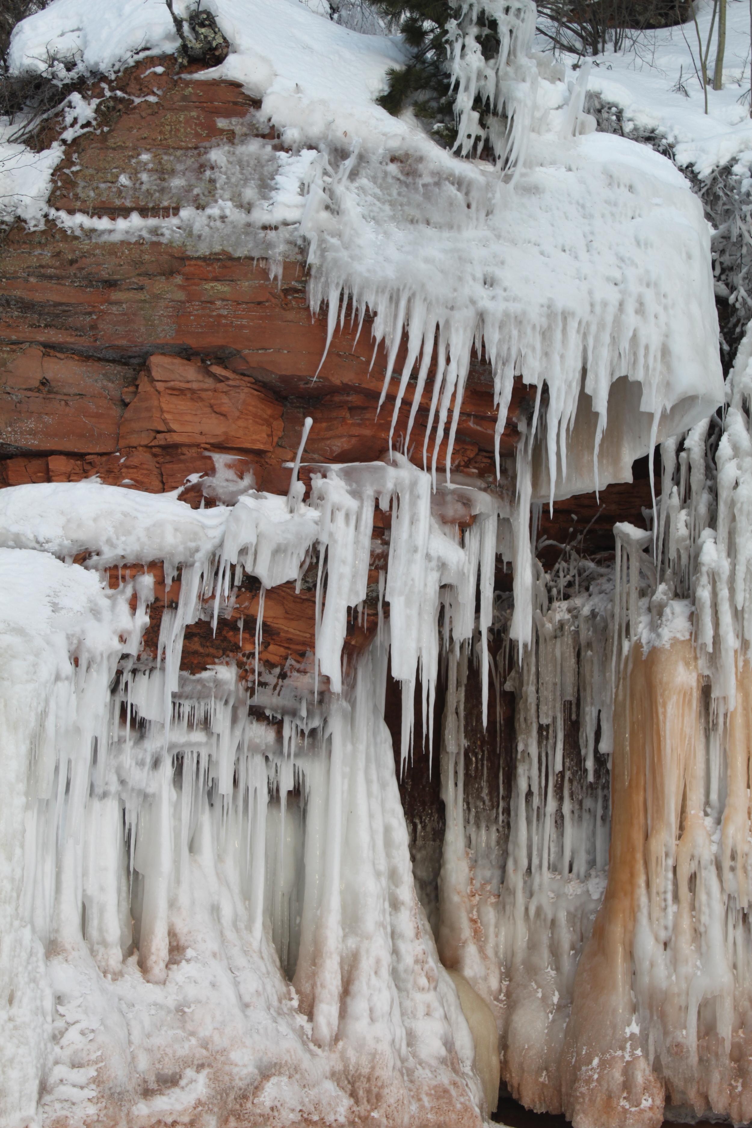 stalactites meeting stalagmites in the rock overhangs