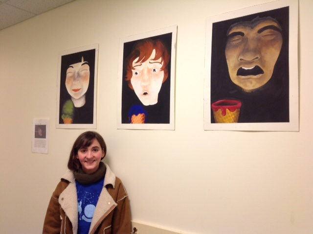 Signe with her paintings
