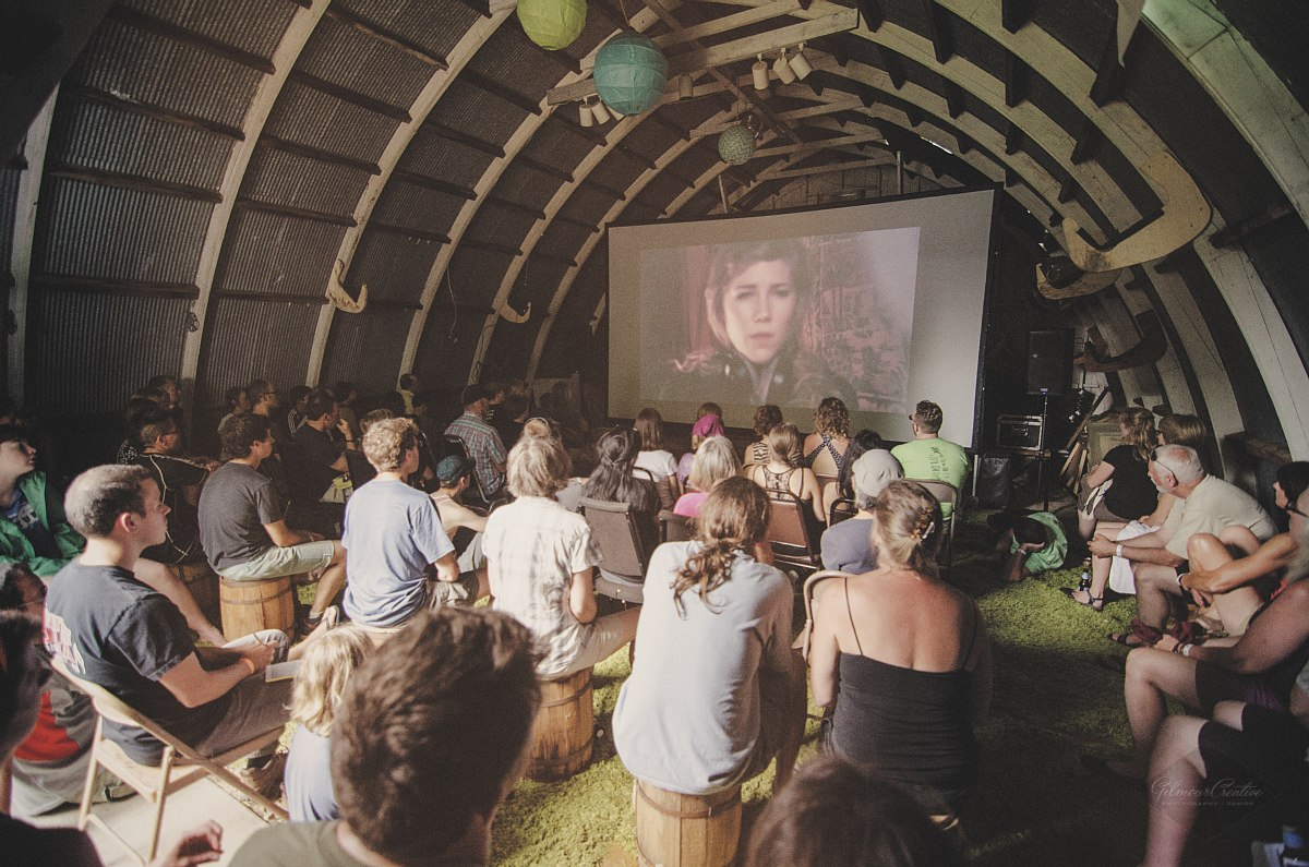 Short films and animations are shown in a small barn during the day and outside at night.
