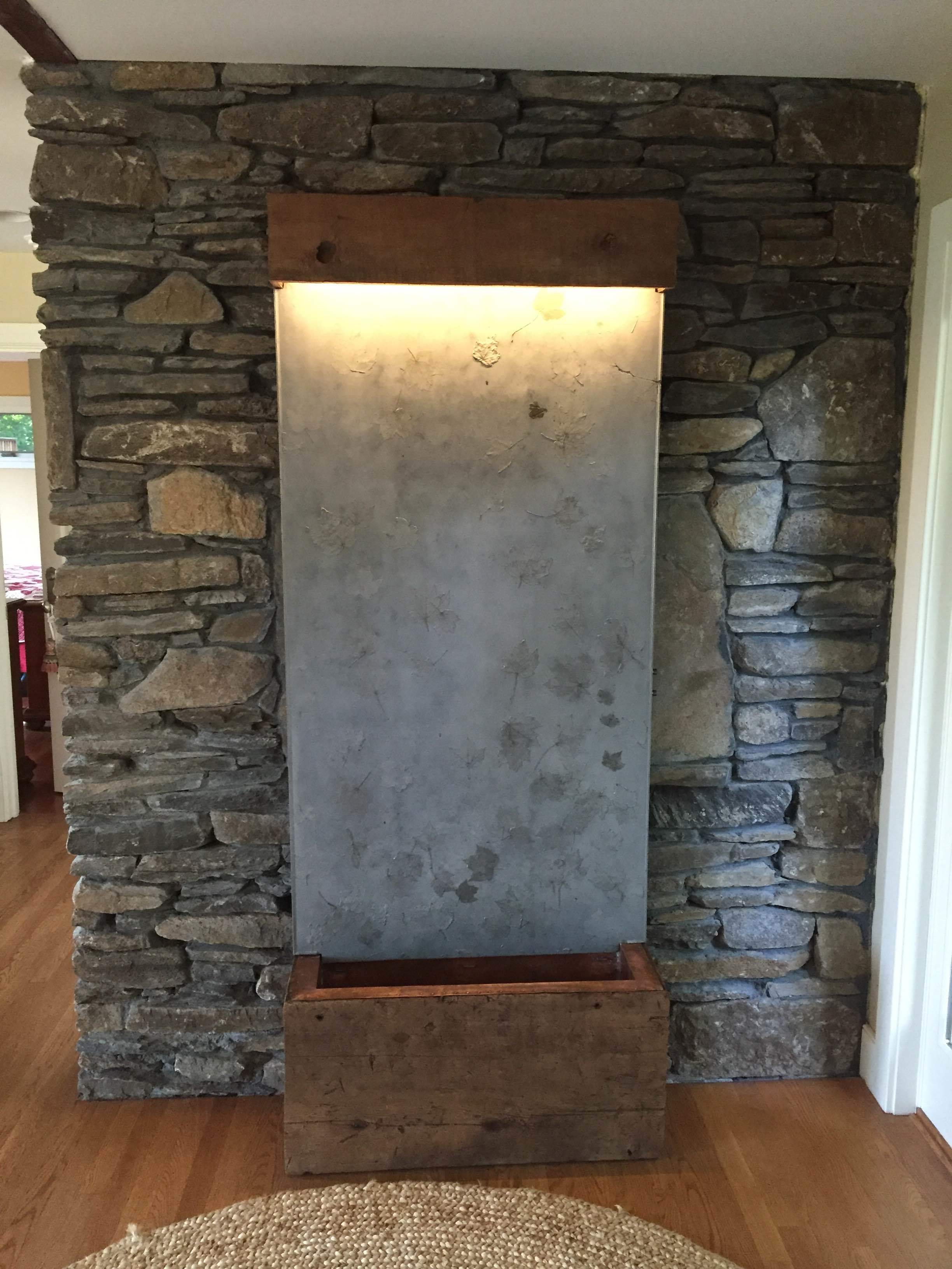 Concrete water wall fountain, with hammered copper basin and reclaimed wood base.