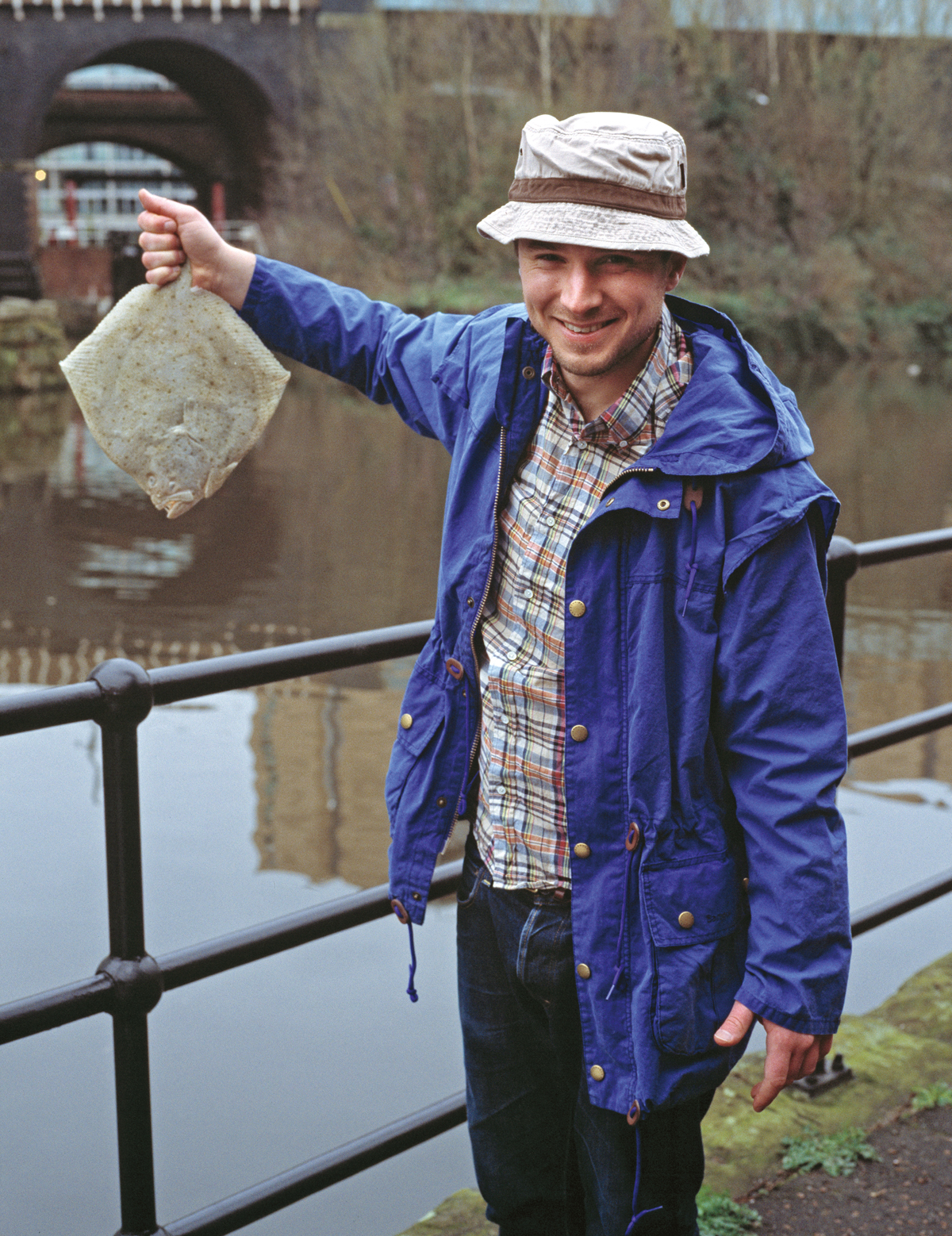 Hat and jacket by Barbour, shirt by Beams+, fish – model's own