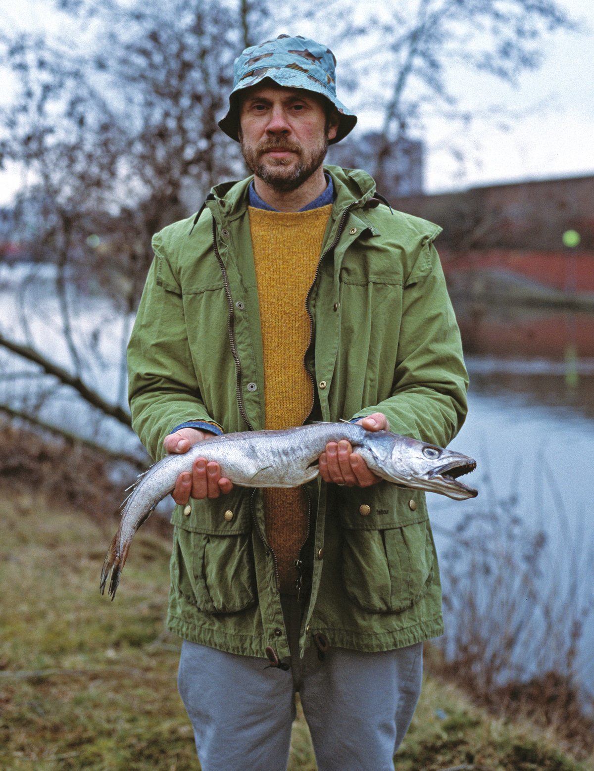 Hat and Jacket by Barbour, knitwear by Howlin', cords by Levi's Vintage Clothing, fish – model's own