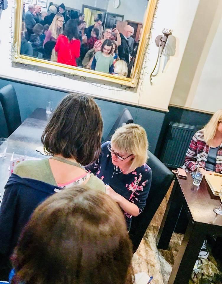 Liz book launch signing.JPG