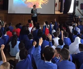 Liz school event assembly w dragon pic.jpg