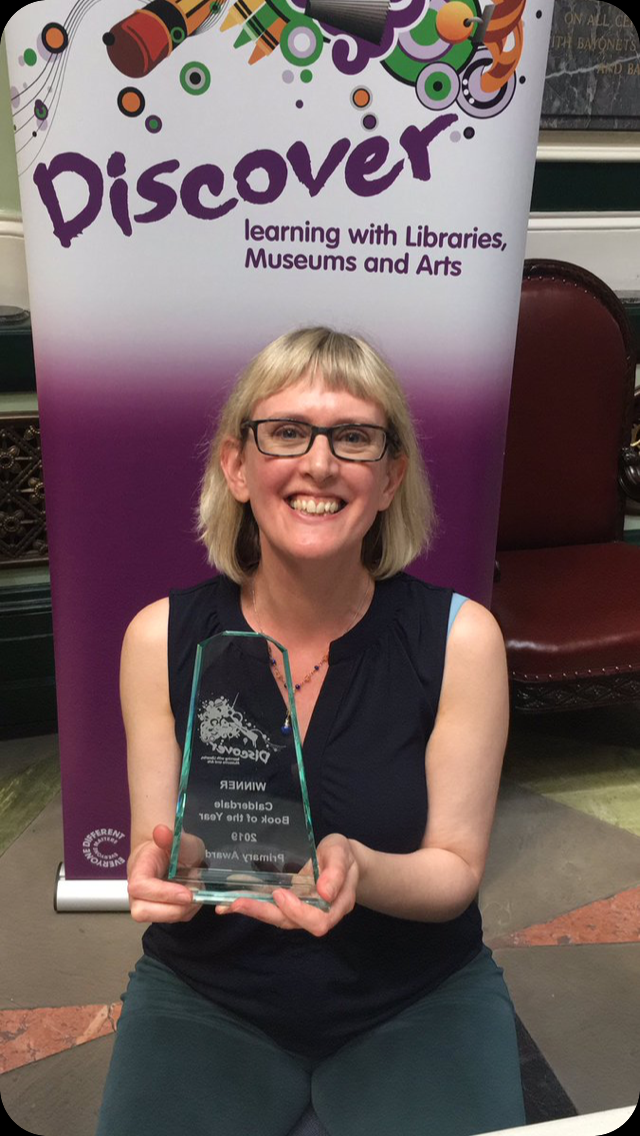 Liz holding the Calderdale Book of the Year award