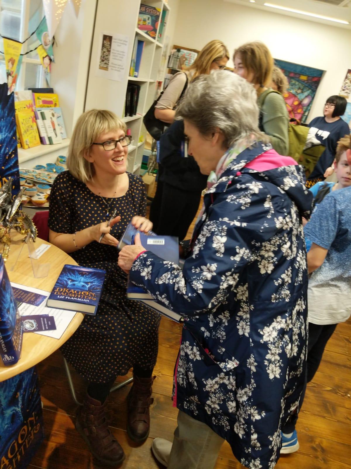 Liz book launch signing books.JPG