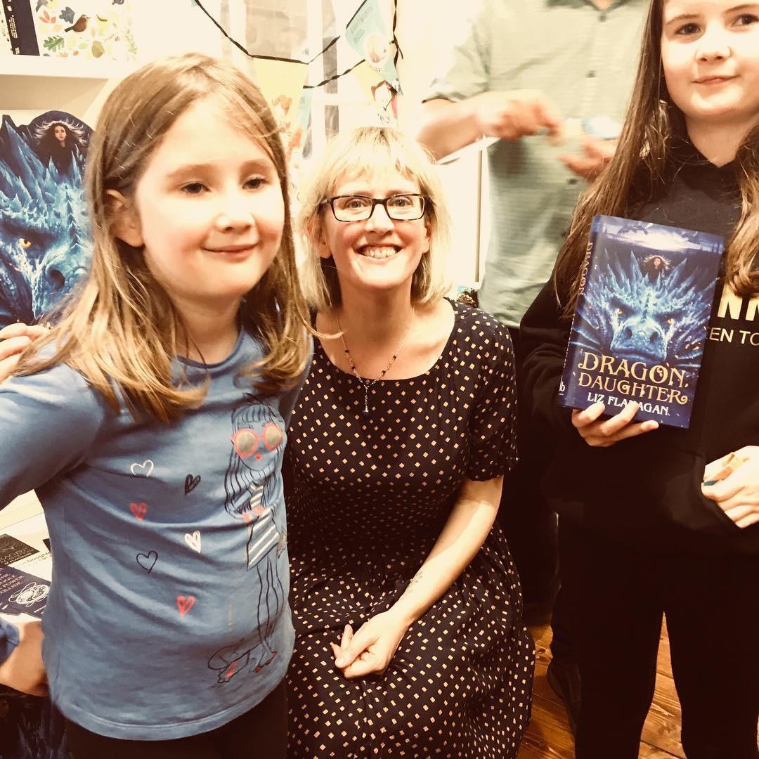 Liz w readers at book launch.JPG