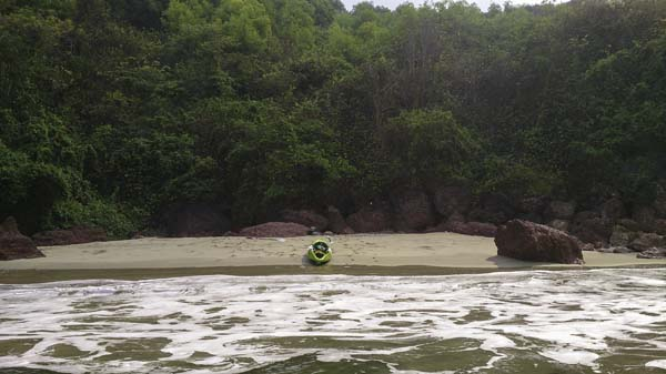a small beach with a kayak