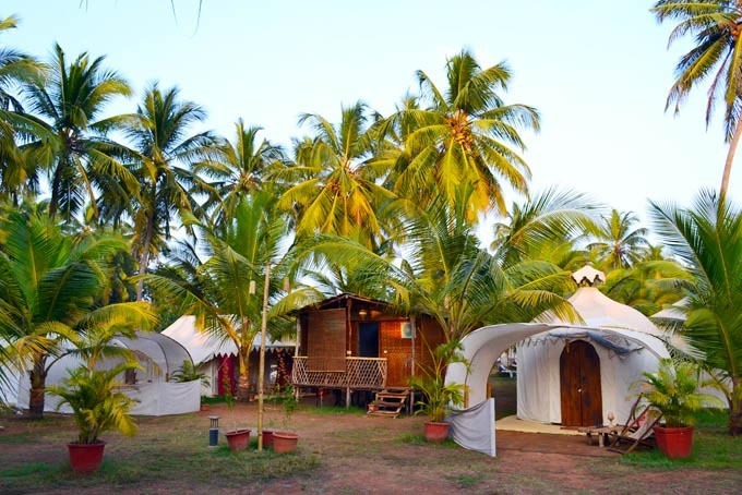 Tent accommodations in morning light at The Mandala Goa