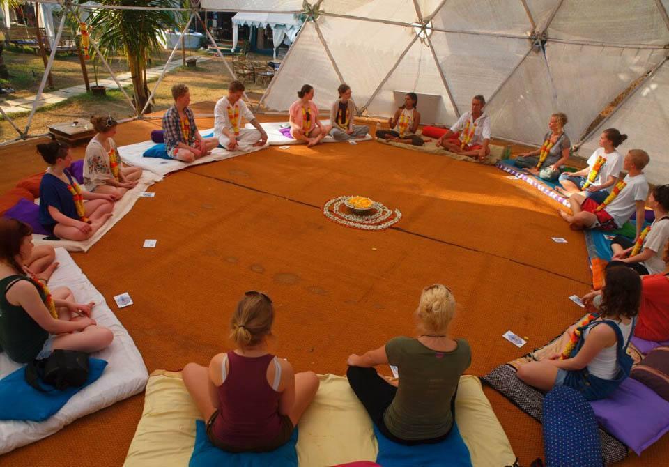 Meditation during yoga class inside a yoga shala