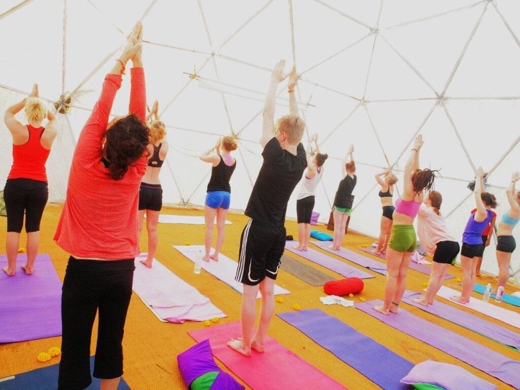 Sun salutations during morning yoga class