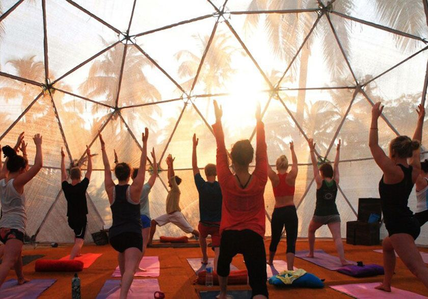 Morning yoga under the early sun inside the dome of The Mandala