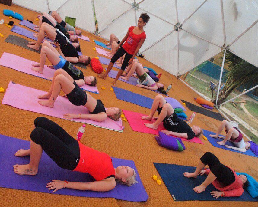 A teacher leads class during a yoga retreat at The Mandala