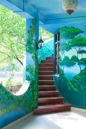 Exterior stairs painted in jungle murals