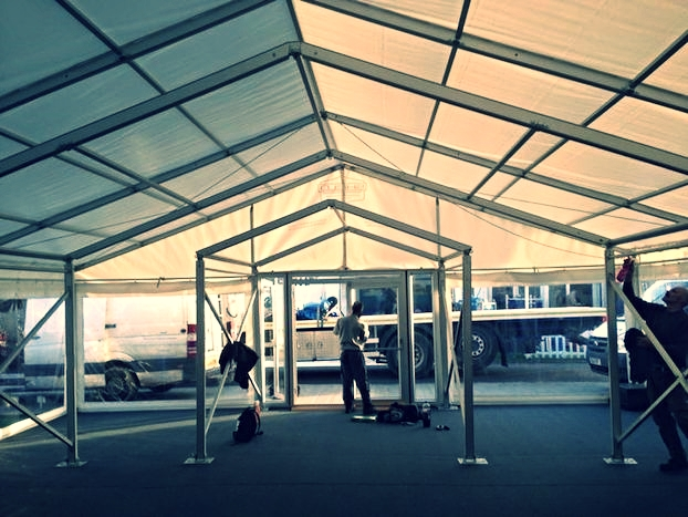 Panoramic ClearMax PVC Windows at the front of Shield's  Showman's Show 2013 marquee  during the outfitting of the marquee.