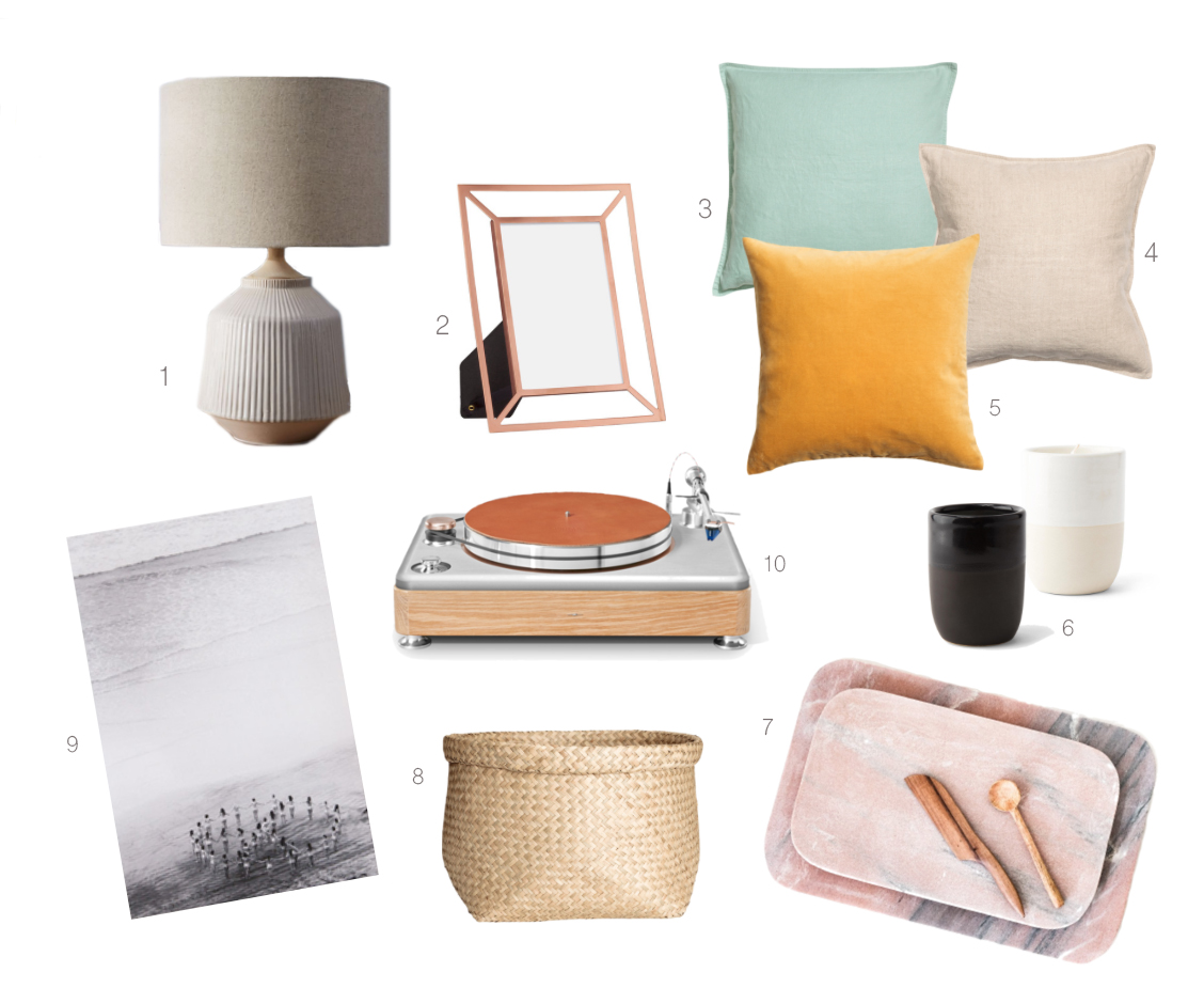 1.  Ceramic table lamp  | 2.  Copper photo frame  | 3.  Linen pillow cover in dusky green  | 4.  Linen pillow cover in linen beige  | 5.  Velvet pillow cover in mustard yellow  | 6.  Norden candles  | 7.  Pink marble tray with copper feet  | 8.  Seagrass storage basket  | 9.  Jamie Street Peace print  | 10.  Rose gold Runwell turntable