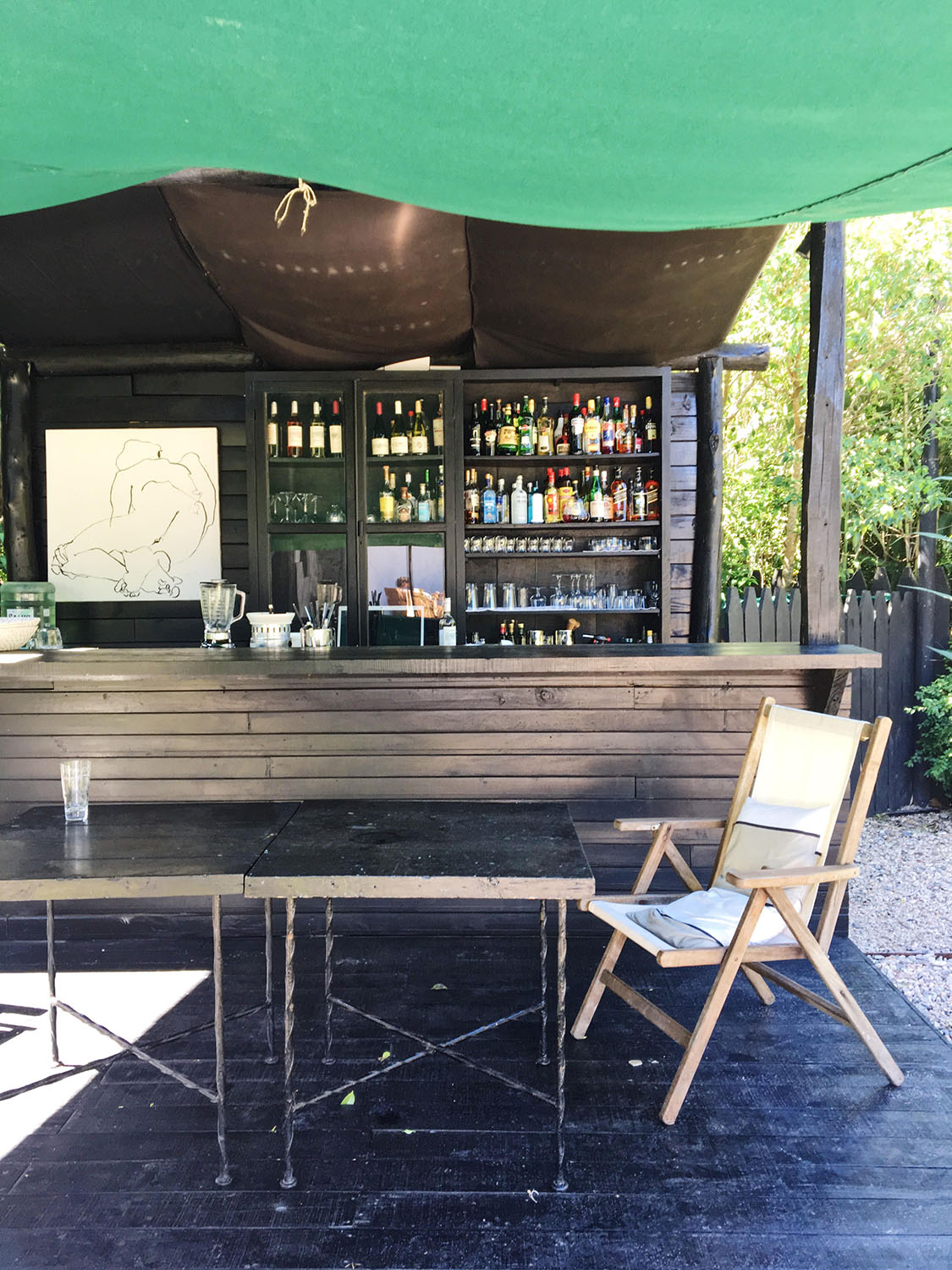 At Garzon: (above) the very chic tented bar in the garden; (below) the dining room; outdoor tables.