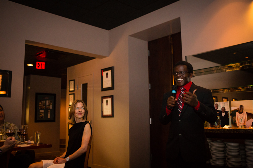 Our Restore Humanity Scholar Vincent speaking to our guests! And the lovely Dr. Allyson Mertins looks on.
