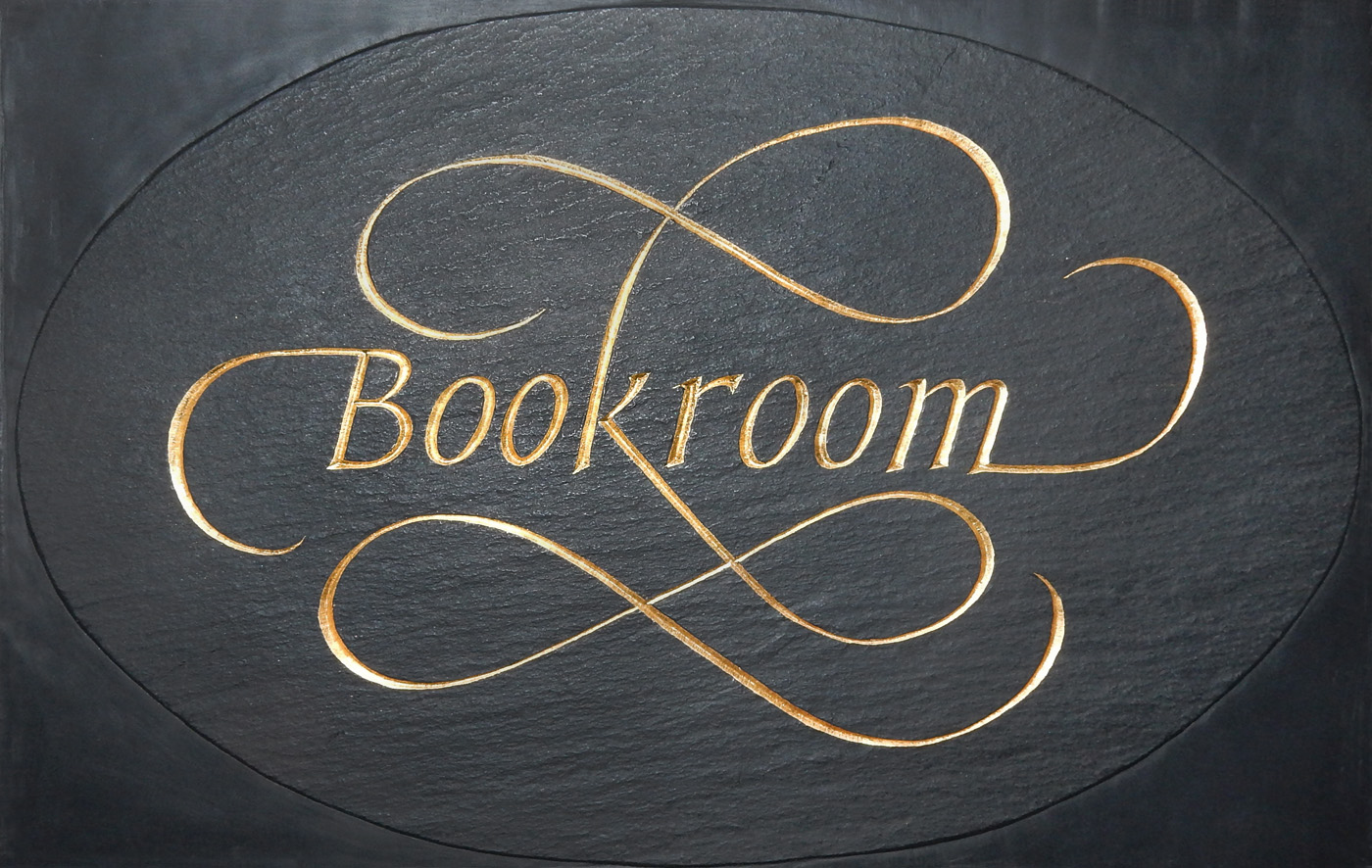 On the door of Rocky Stinehour's Book room, cut in slate by Christopher Stinehour.