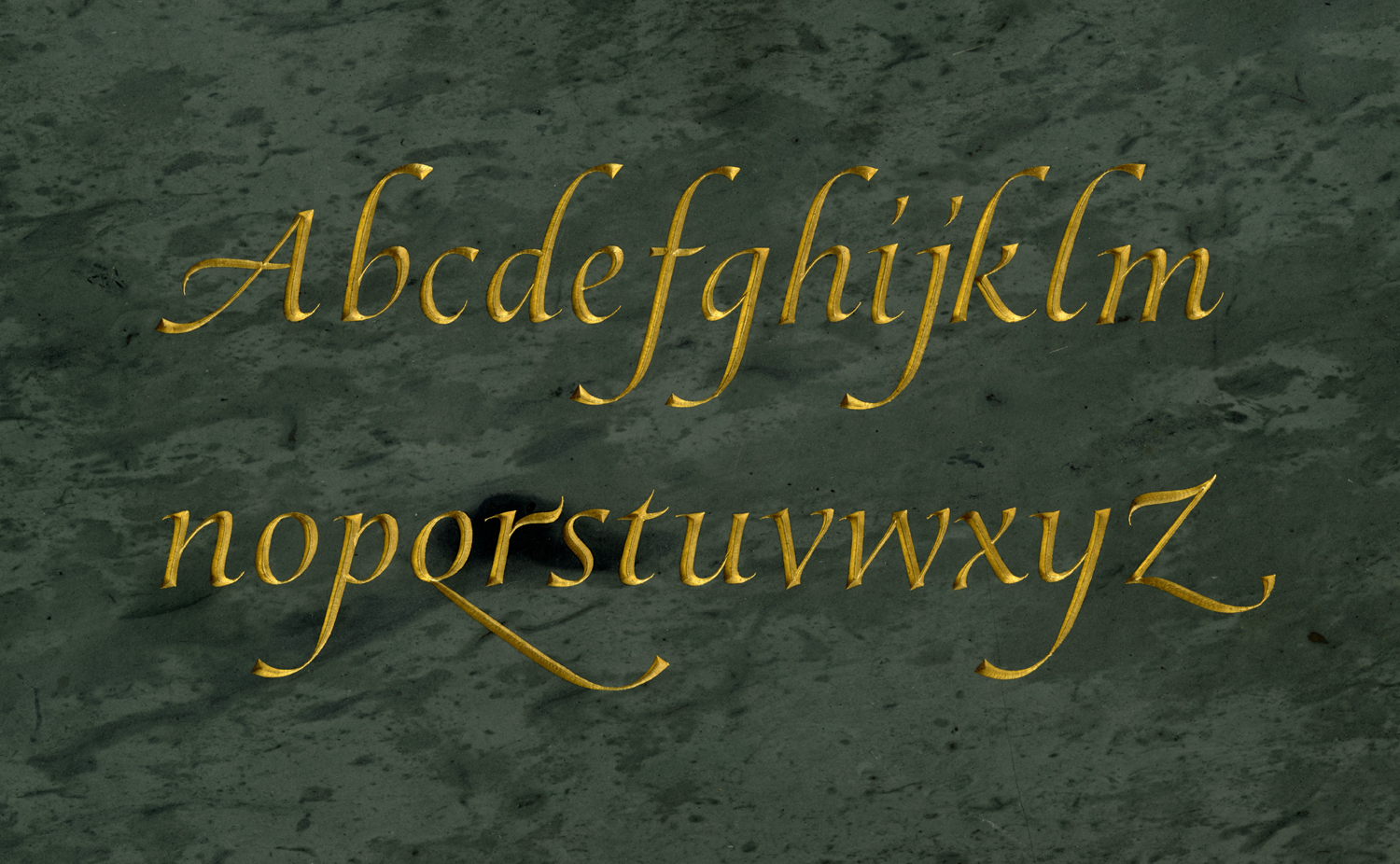 Italic Alphabet in Green Slate  Drawn and cut by Christopher Stinehour  Visit the website of   Christopher Stinehour Design