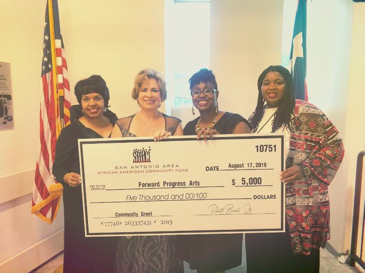 big check with laticia.jpg